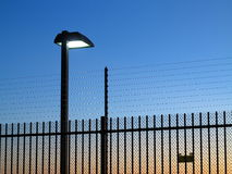 Safety fence lighted by dusk Royalty Free Stock Photos