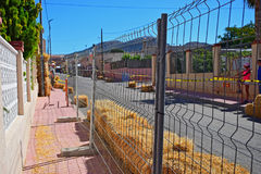 Safety Fencing At Motorcycle Race. Looking through the safety fencing during the Algueña motorcycle race in Spain stock photography