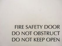 Safety fire exit sign Stock Photography