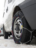 Safety first!. Snow chain mounted on car tire Stock Photo