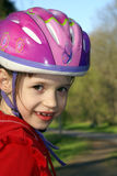 Safety first. Little girl wearing a pink protective helmet Stock Photo