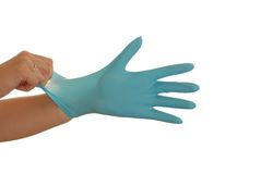 Safety first!. Hand is pulling a blua glove Royalty Free Stock Photography