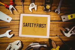 Safety first against architect background Stock Images