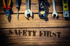 Safety first against desk with tools Stock Photo