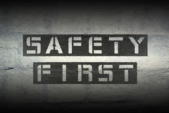 Safety first. Black stencil print on the grunge white brick wall Royalty Free Stock Image