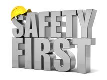 Safety first concept. Safety first 3d text with construction helmet Royalty Free Stock Image