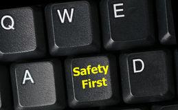 Safety first concept with yellow key on computer keyboard Royalty Free Stock Photography
