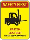 Safety first - fasten seat belt. Sign fasten seat belt when using forklift! Safety first Royalty Free Stock Photo