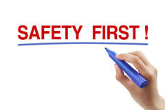 Safety First. Hand with blue marker is drawing a line under the text Safety First isolated on white background royalty free stock images