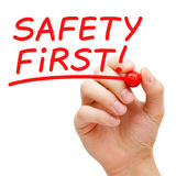 Safety First. Hand writing Safety First with red marker on transparent wipe board royalty free stock photography