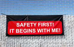 Safety First. Huge Safety First sign attached to tall metal gate Royalty Free Stock Photo