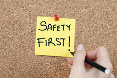 SAFETY FIRST. Note pinned on cork noticeboard Stock Images