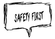SAFETY FIRST on a pencil sketched sign. Stock Images