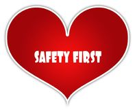 SAFETY FIRST on red heart sticker label. Illustration concept Royalty Free Stock Photo