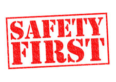 SAFETY FIRST. Red Rubber Stamp over a white background Stock Image