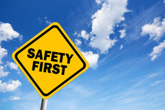 Safety first road sign. Safety first illustrated sign over blue sky Stock Images