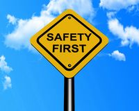 Safety first sign. On a post with blue sky background Royalty Free Stock Photo