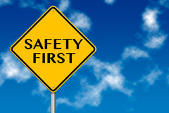 Safety First Sign. Showing business concept on a sky background Royalty Free Stock Photo