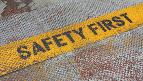Safety First Sign on caution strip. Stock Photography