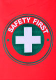 Safety first sign on red cotton flag royalty free stock photos