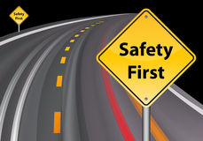 Safety first sign, road background  Royalty Free Stock Images