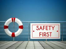 Safety First sign at the swimming pool, lifebuoy Stock Photo