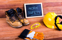 Safety first. Standard construction safety equipment on wood background Royalty Free Stock Photo