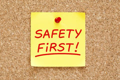Safety First Sticky Note. Safety First written on yellow sticky note with red marker royalty free stock photos