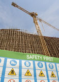 Safety first symbol in construction site. Safety first symbol warning in construction site stock images
