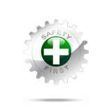 Safety first symbol on gear icon Stock Images
