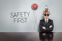 Safety first text with vintage businessman royalty free stock image