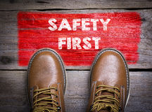 Safety First. Top View of Boot on wooden background Royalty Free Stock Photo