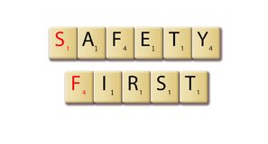 Safety first words arranged in a wooden tile stock photography