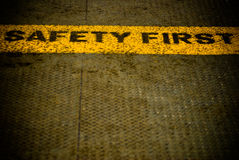 Safety first words on the metal ground Stock Photo