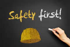 Safety first! written on blackboard stock image