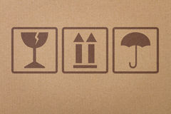 Safety, fragile icons. On a cardboard parcel Royalty Free Stock Photography