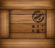 Safety fragile sticker icon on texture wooden box Stock Photography