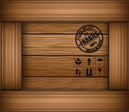 Safety fragile sticker icon on texture wooden box Royalty Free Stock Image
