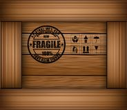 Safety fragile sticker icon on texture wooden box Royalty Free Stock Photos