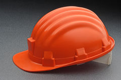 Safety gear. Orange safety gear on a gray background Royalty Free Stock Photos