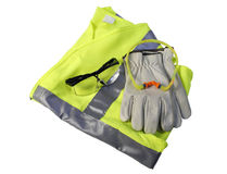 Safety Gear II. A yellow highway safety vest with a set of earplugs, safety glasses and a pair of leather gloves Royalty Free Stock Image