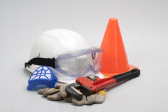 Safety gear kit. Close up on grey background Royalty Free Stock Images