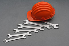 Safety gear and wrenches Stock Photo
