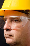 Safety Glasses. A man with a hard hat wearing safety glasses Stock Image