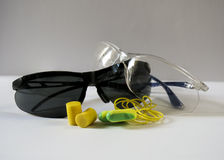 Safety glasses and ear plugs Stock Image