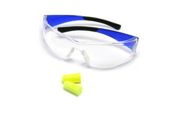 Safety Glasses and Earplugs. Plastic safety glasses and disposable earplugs Royalty Free Stock Photos