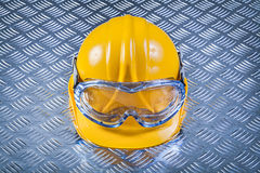 Safety glasses hard hat on grooved metal plate construction conc Stock Images