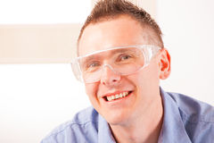 Safety glasses. Man wearing protective safety glasses Royalty Free Stock Photo