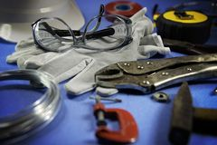Safety glasses and other tools. Safety glasses and othe tools on a working table stock photos