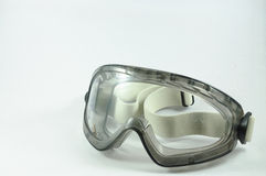 Safety glasses. A pair of lenses set in a frame resting on the nose and ears, used to correct or assist defective eyesight or protect the eyes Stock Photo